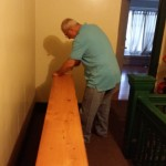 Sawing the shelves to make them fit.