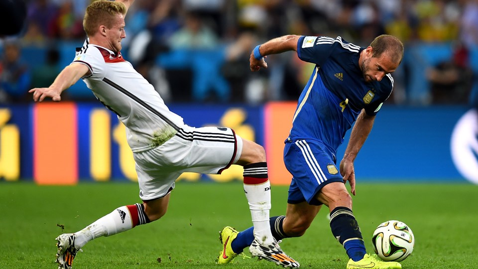 Pablo Zabaleta of Argentina and Andre Schuerrle of Germany compete for the ball during the 2014 FIFA World Cup Brazil Final match between Germany and Argentina at Maracana on July 13, 2014 in Rio de Janeiro, Brazil. (Photo by Mike Hewitt - FIFA/FIFA via Getty Images)